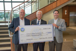 Joe Burke (center), interim president at Calhoun Community College, with Terry Abel (left) and Dan Merenda of the National Space Club Scholarship Education Committee.