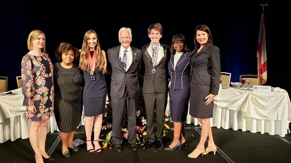 2019 All Alabama Academic Team members Chloe McAlpin (third from left) and Greg Lucero (third from right) with PTK advisors, Calhoun president Dr. Joe Burke, and Vice President of Student Services Dr. Pat Wilson. Also pictured is 2020 All Alabama Academic Team member Tatayana Rice (second from left)